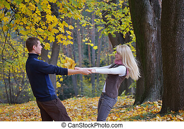 Couple in autumn park - Happy couple in the autumn park...