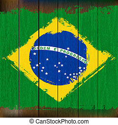 Grunged Brazilian Flag over a wooden plank background...