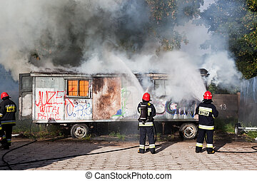 Firefighters fighting a fire of a waste place - Gdansk,...