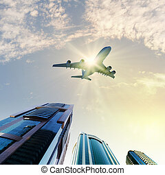 Airplane above city - Image of airplane flying above...