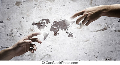 Global interaction - Close up of human hands touching with...