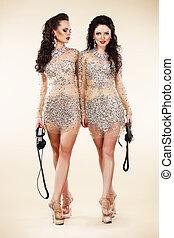 Luxury. Two Trendy Women Walking in Shiny Bright Dresses