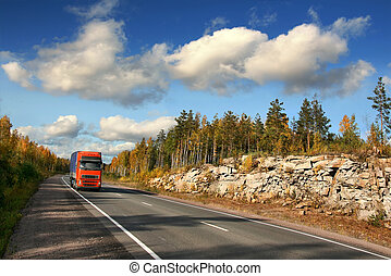 red trucking - red truck on autumn highway