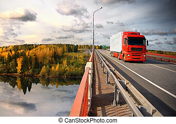 Baltic trucking - truck and bridge over Saima channel,...