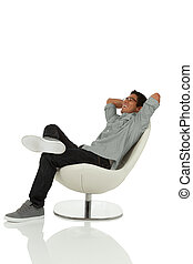 Young adult relaxing in chair