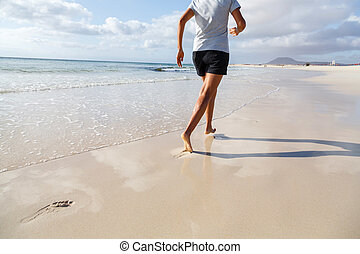 Jogging on beach - Asian Indian woman running on beach...