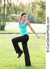 Aerobics outdoor - Young woman practicing aerobics exercise...