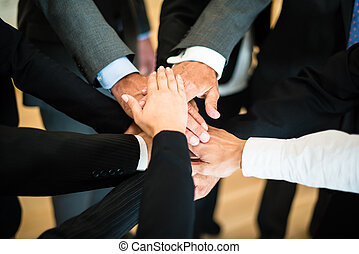 Teamwork - stack of hands - Multiracial group of nine...