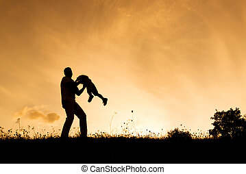 Happy family - Silhouette of happy father having fun with...