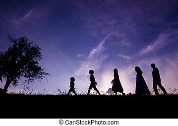 Happy family - Silhouettes of happy parents having fun with...
