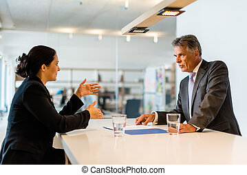 Job interview - Recruiter middle aged business man checking...