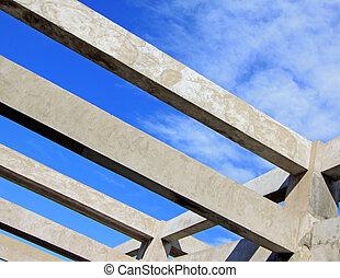 Concrete pouring construction under the blue sky