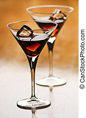drink - beautiful liqueur in martini glass close up shoot