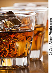 whiskey - glass of whiskey with ice close up shoot