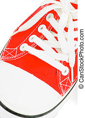 Red Gym Shoe - Trendy Red Gym Shoe closeup on white...