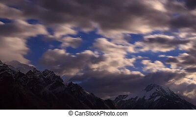 Moonrise in the mountain. Time Lapse. Kyrgyzstan, Central...