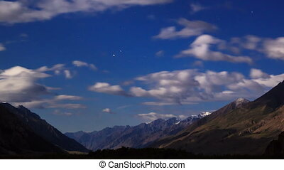Moonlit night in the mountains. Time Lapse. Kyrgyzstan,...