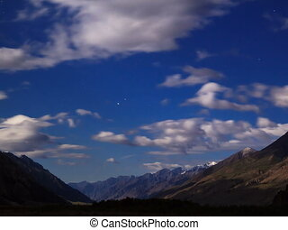 Moonlit night in the mountains. Time Lapse. 4x3 - Moonlit...