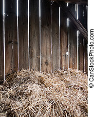 Hay-barn - Straw in the old barn with timber wall