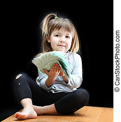 Money - Child with euro money on black background