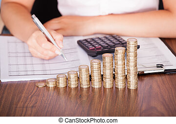 Woman Calculating Financial Work - Close-up Of Woman At Work...