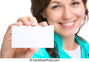 Doctor is showing her business card - Young woman doctor is...