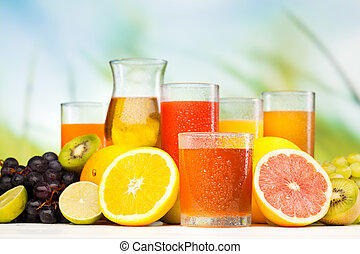 glasses of juice, fruits