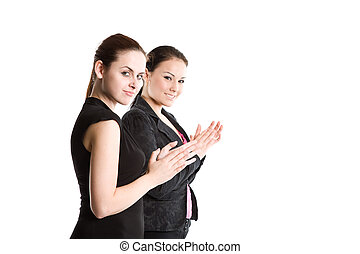 Two businesswomen clapping hands