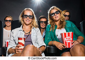 Friends Watching 3D Movie In Theater - Portrait of happy...