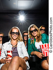 Young Friends Watching 3D Movie In Theater - Group friends...