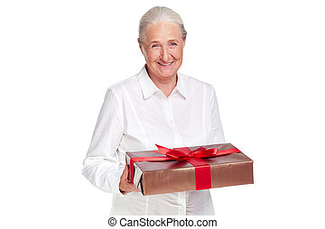 Female with gift - Portrait of elderly female with giftbox...