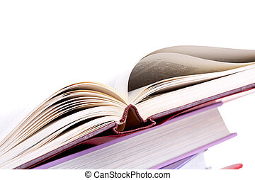 Open book - Colorful stack of textbooks with open book on...