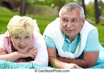 Day in the country - Happy mature couple having rest in the...