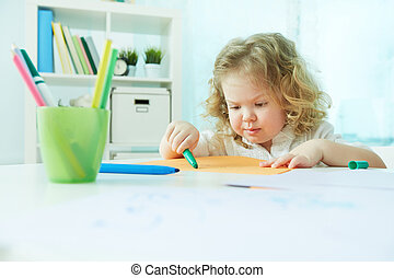 Diligent cutie - Diligent preschool child drawing at home