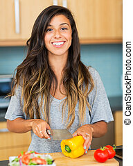 Young Woman Cooking. Healthy Food - Young Woman Cooking...
