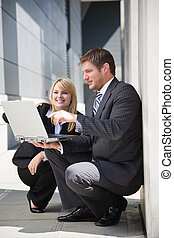 Working caucasian business people - A shot of two caucasian...