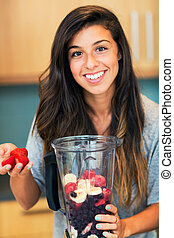 Making Fruit Smoothie - Beautiful Young Woman Making Fruit...