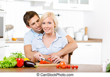 Young couple preparing breakfast together - Young couple...
