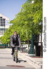 Caucasian businessman riding a bicycle