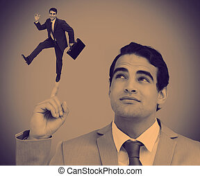 Businessman showing shrunk colleague posing on his finger -...