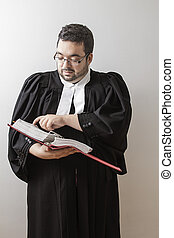 Flipping the page - Overweight man in canadian lawyer toga,...