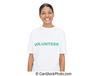 Smiling model wearing volunteer tshirt posing on white...