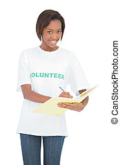 sonriente, voluntario, mujer, escritura, cuaderno