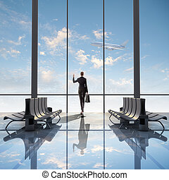 Business travel - Image of woman in airport looking at...