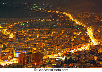 City in night with buildings and lights