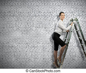 Ladder of success - Image of young ambitious businesswoman...