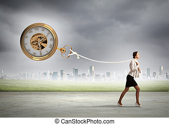 Time concept - Image of attractive businesswoman and pocket...