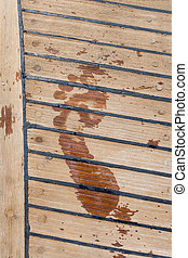 footprint on the wooden deck sailing ship