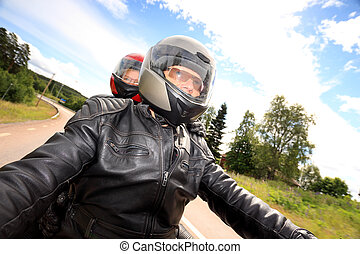 adult man and woman bikers on the road - Adult couple taking...