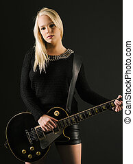 Gorgeous blond playing electric guitar